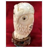 "Carved bone owl on a hardwood base, 2.75"" tall ove"