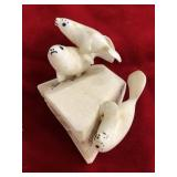 Group of 3 swimming seals, by S. Seeganna, about 2