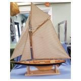 Beautiful handmade model of a single masted sail b