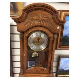 Howard Miller 8 day wall hanging clock, with pendu