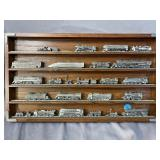 OAK SHADOW BOX WITH 24 PEWTER TRAINS