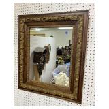 CARVED OAK AND GILDED MIRROR
