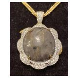 .925 SILVER RUBY AND WHITE SAPPHIRE PENDANT AND