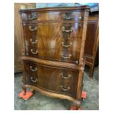 SWAN CARVED FLAMED MAHOGANY TALL CHEST