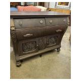 OAK HEAVY CARVED BUFFET WITH FACES