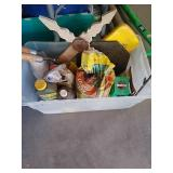 Tote with gardening chemicals including