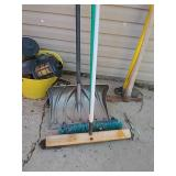 Snow shovel and two brooms