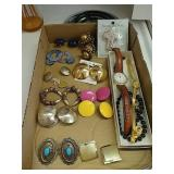 Selection of costume jewelry earrings and watches