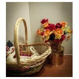 Large woven basket with brass planter, brass wall
