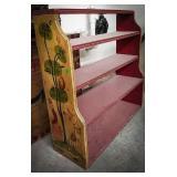 Wooden free-standing display shelf with folk art