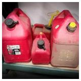 Four gas cans including two 5-gallon and two 1