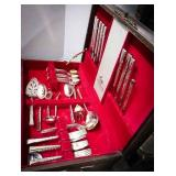 Beautiful wooden silverware box with a set of