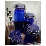 Set of 4 cobalt blue canisters with two glass