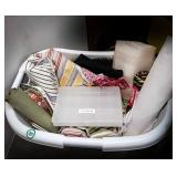 Laundry basket full of fabric, organizer boxes