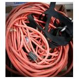 2 orange extension cords with three prongs, black