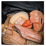 Several styles of leather holsters including