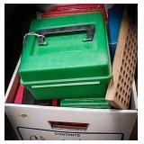 Box full of empty ammunition boxes and ammunition