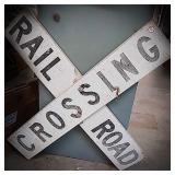 Railroad crossing metal sign measuring 40 by 40
