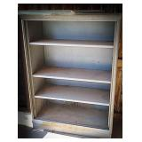 Metal shelving unit with 4 shelves