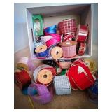 Large quantity of fabric ribbons filling a file