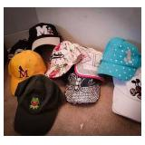 Ladies style baseball caps, some still new with
