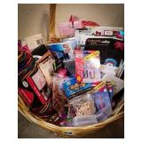 Wicker basket filled with notebooks, cards,