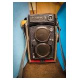 Yashica Mat-124 G camera comes with black leather