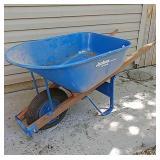 Metal Jackson wheelbarrow .... tire needs air.