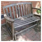 Wooden rocking outdoor bench needing repair