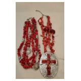 Red and Silver Colored Jewelry.