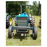 Blue Ford tractor with lot 13 on the back