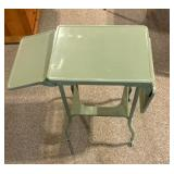Small metal drop leaf table on wheels