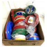 Box full of plastic plates and bowls