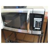 Contents of Locker Room: Lockers, Refrigerator, Mi