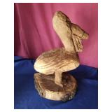 pelican  chain saw carving