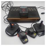 Atari 2600 w/ Games, Controllers, and cords