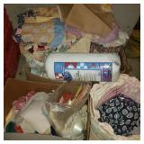 Boxes of Fabric, Quilts, and Table Coths