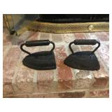 Two antique cast-iron, irons
