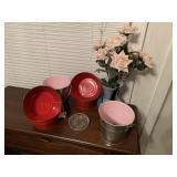 Six metal pails and floral arrangement in vase