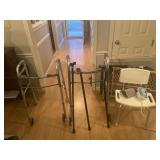 Two walkers, three canes, shower chair, blood