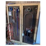 Pegboard storage cabinet (content not included)