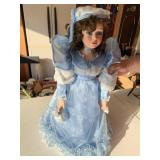 Doll and blue dress