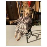 Doll in wooden chair