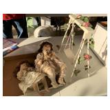 Two dolls and swingset