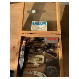 Shadowbox with knives, buckles, MISC