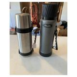 Two metal thermoses