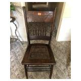 Carved spindle back cane woven chair
