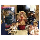 Assortment of dolls & plastic doll bed