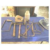 Assortment of tools, vintage cowboy hat, stirrup