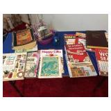 Assortment of books & pencil sharpener